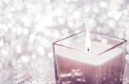 Festive decoration, branding and aromatherapy spa concept - Blush pink aromatic candle on Christmas and New Years glitter background, Valentines Day luxury home decor and holiday season brand design