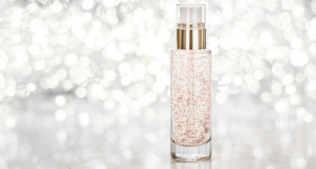 Cosmetic branding, blank label and glamour present concept - Holiday make-up base gel, serum emulsion, lotion bottle and silver glitter, luxury skin and body care cosmetics for beauty brand ads Standard-Bild