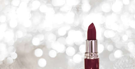 Cosmetic branding, sale and glamour concept - Chocolate lipstick on silver Christmas, New Years and Valentines Day holiday glitter background, make-up and cosmetics product for luxury beauty brand
