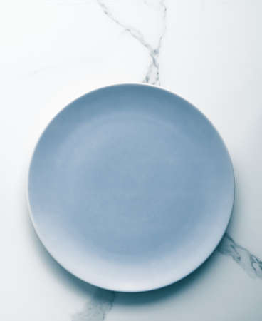 Blue empty plate on marble, flatlay - stylish tableware, table decor and food menu concept. Serve the perfect dish