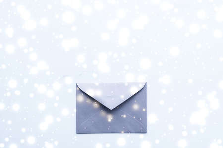Greetings, postal service and online newsletter concept - Winter holiday blank paper envelopes on marble with shiny snow flatlay background, love letter or Christmas mail card design Stock Photo