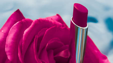 Cosmetic branding, luxe and fashion concept - Pink lipstick and rose flower on liquid background, waterproof glamour make-up and lip gloss cosmetics product for luxury beauty brand holiday design Stock fotó