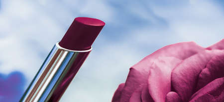 Cosmetic branding, luxe and fashion concept - Purple lipstick and rose flower on liquid background, waterproof glamour make-up and lip gloss cosmetics product for luxury beauty brand holiday design