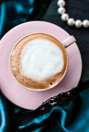 Menu, branding and recipe concept - Cup of cappuccino for breakfast with satin and pearls jewellery background, organic coffee with lactose free milk in parisian cafe for luxury vintage holiday brand