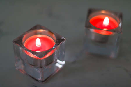 Aromatic candles for romantic atmosphere at home, interior and decor close-up