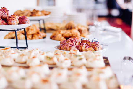 Pastry buffet served at charity event, sweet food and dessert table setting
