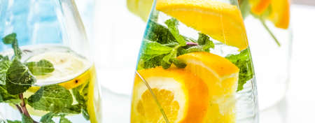 Fruit-flavoured water or soda drinks served at charity event, close-up