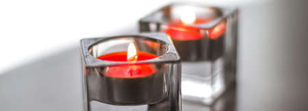 Aromatic candles for romantic atmosphere at home, interior and decor close-up Banco de Imagens