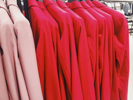 Clothing on display in a boutique store in shopping mall, fast fashion concept