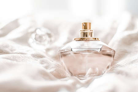 Perfume bottle with aromatic floral scent, luxury fragrance for women