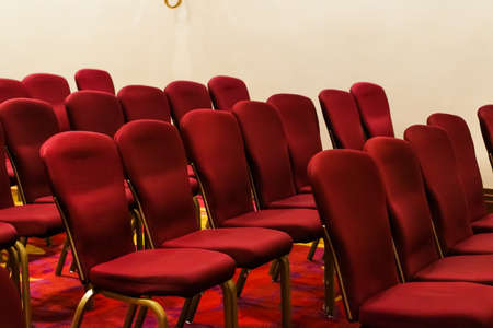 Empty chairs in a hotel conference room, business and interior design concept
