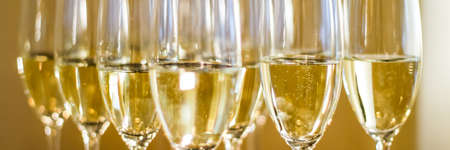 Glasses of champagne and sparkling wine served at charity event, alcoholic drinks close-up