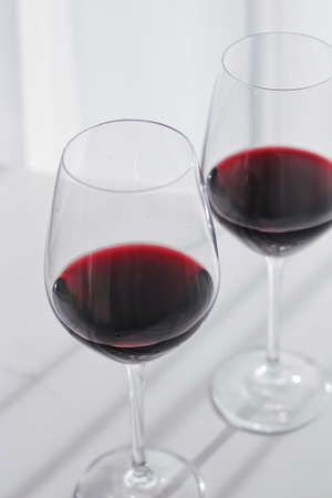 Two crystal glasses of red wine, organic beverage product Banco de Imagens