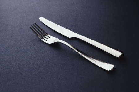 Fork and knife, silver cutlery for table decor, minimalistic design and diet concept Stock Photo
