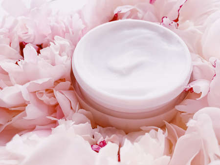 Face cream moisturizer on floral background as luxury skincare cosmetics, healthcare and beauty product concept