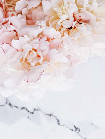 Bouquet of peony flowers on luxury marble background, wedding flatlay and event branding design