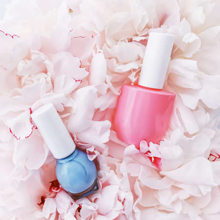 Nail polish bottles on floral background, french manicure and cosmetic branding design