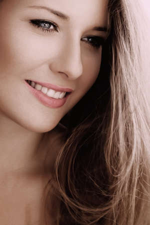 Elegant woman smiling, brunette with long light brown hair, girl wearing natural makeup look, female showing healthy white teeth, beauty portrait for cosmetic or lifestyle brands
