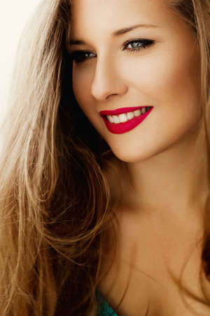 Charming woman smiling, brunette with long light brown hair, girl wearing natural makeup look, female showing healthy white teeth, beauty portrait for cosmetic or lifestyle brands