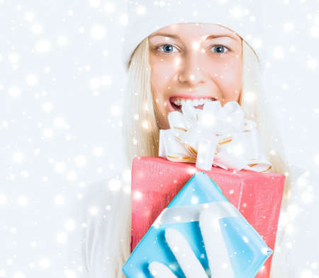 Young woman celebrating Christmas time, happy smiles
