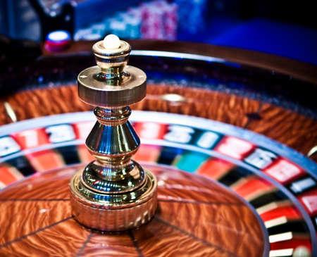 Roulette wheel in casino, gambling ads