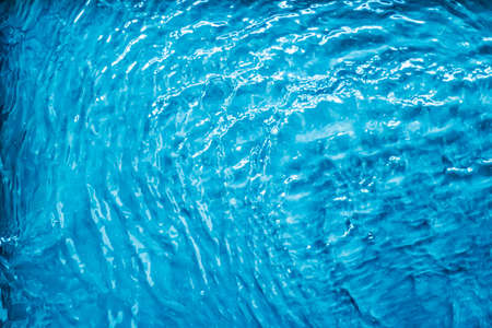 Blue water texture as abstract background, swimming pool and waves designs