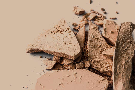 Beige eye shadow powder as makeup palette closeup, crushed cosmetics and beauty textures