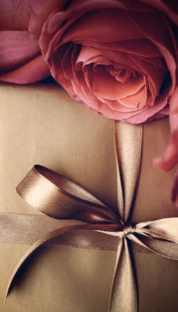 Vintage design, shop sale promotion and happy surprise concept - Luxury holiday golden gift box and bouquet of roses as Christmas, Valentines Day or birthday present