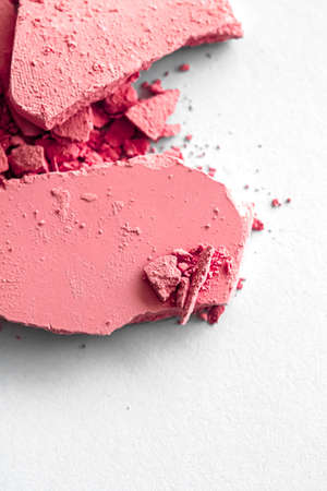 Red eye shadow powder as makeup palette closeup isolated on white background, crushed cosmetics and beauty textures