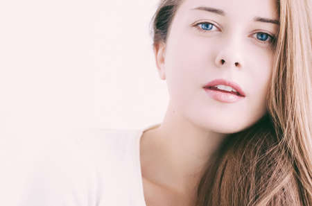 Beauty face portrait of a young woman, natural makeup look, skincare and hair care brand