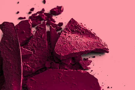 Burgundy eye shadow powder as makeup palette closeup, crushed cosmetics and beauty textures