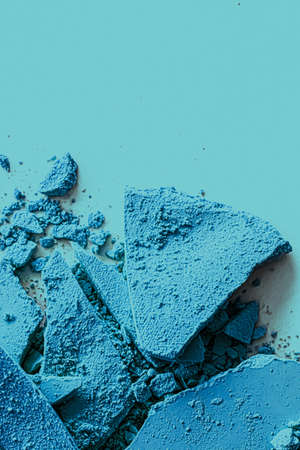 Blue eye shadow powder as makeup palette closeup, crushed cosmetics and beauty textures