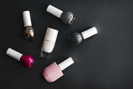 Nail polish bottles on black background, beauty branding Zdjęcie Seryjne