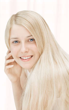 Beauty face close-up of young woman, blonde hair and chic make-up for skincare and haircare brand ads