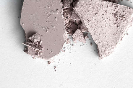 Pale eye shadow powder as makeup palette closeup isolated on white background, crushed cosmetics and beauty textures