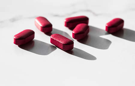 Red pills as herbal medication, pharma brand store, probiotic drugs as nutrition healthcare or diet supplement products for pharmaceutical industry ads
