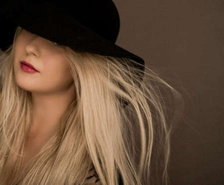 Classy blonde woman wearing a hat, artistic film portrait for fashion campaign and beauty brand design Reklamní fotografie