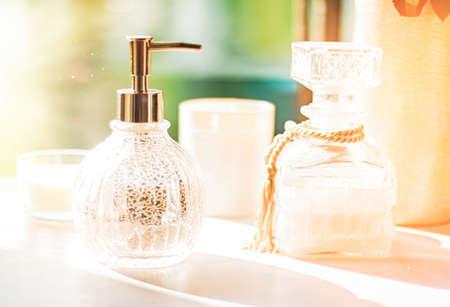 Soap dispenser at bathroom spa, home decor and interior design. Hand cream or antibacterial liquid sanitiser, virus protection and hygiene