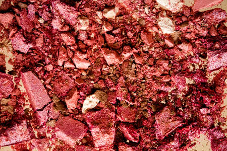 Crushed cosmetics, mineral organic eyeshadow, blush and cosmetic powder isolated on golden background, makeup and beauty banner, flatlay design Standard-Bild