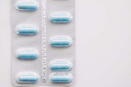 Blue pills and capsules as nutrition supplement, wellness and health care