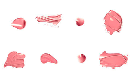 Coral beauty cosmetic texture isolated on white background, smudged makeup emulsion cream smear or foundation smudge, crushed cosmetics product and paint strokes Standard-Bild