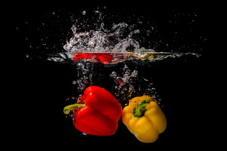 space for type: Peppers under water Stock Photo