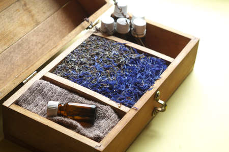 essential oils: Wooden chest with herbs and essential oils
