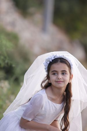 Girl celebrating her First Communion Stock Photo
