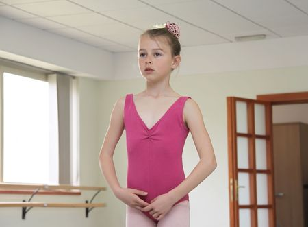 Young girl focusing at the teacher during her ballet lesson Stock Photo - 7413101