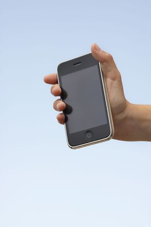 Hand holding up an phone with a plastic invinsible shield cover towards a blue sky