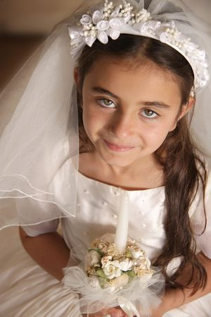 the first communion: Girl celebrating her First Communion. Happy feeling. Horizontal photo Stock Photo
