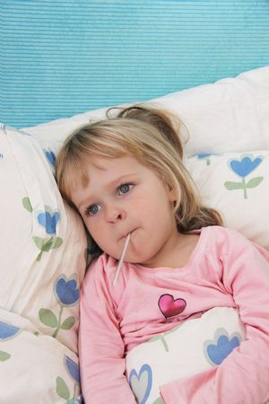 Checking temperature of sick little girl photo