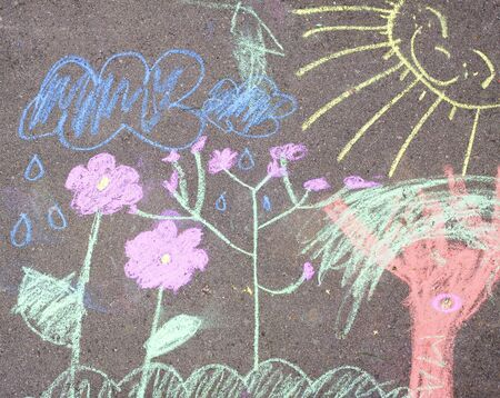 A detail of a child's colourful chalk picture on the pavement Stock Photo - 7632580