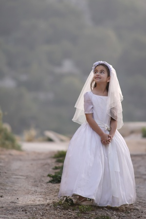 the first communion: Girl celebrating her first communion